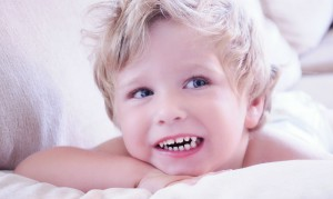 Причины прорезывания у детей коренных зубов